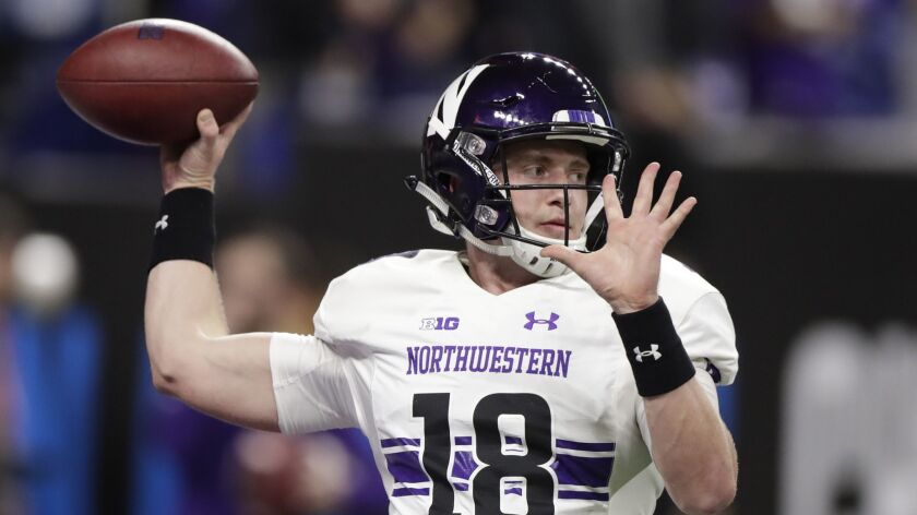 Northwestern quarterback Clayton Thorson warms up for the Big Ten championship NCAA college football