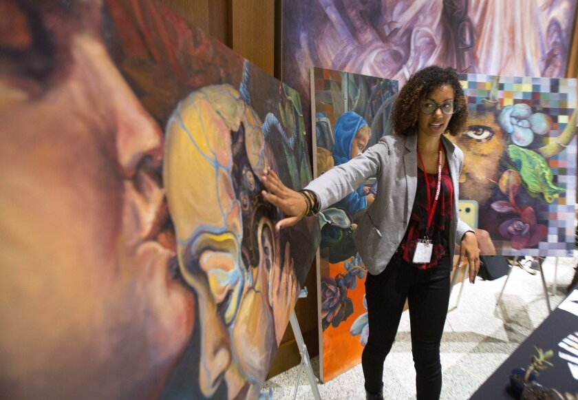 Charlene Mosley, a senior in the School of Art and Design at San Diego State University, discusses one of her works.