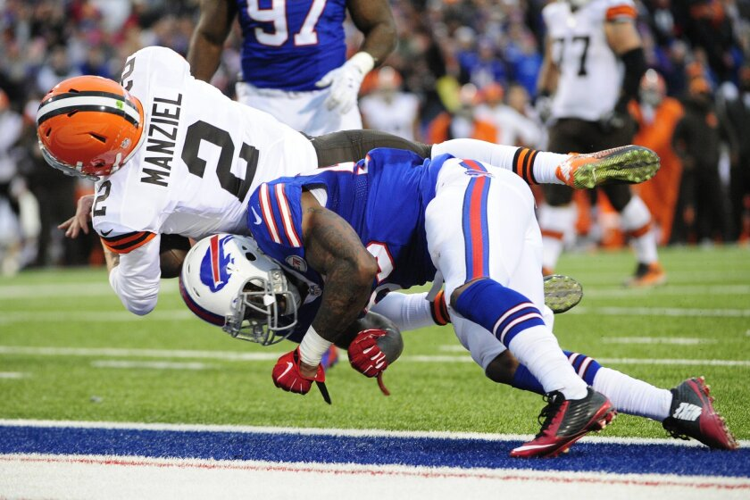 Cleveland Browns quarterback Johnny Manziel (2) dives in for a touchdown score against the Buffalo Bills during the second half of an NFL football game, Sunday, Nov. 30, 2014, in Orchard Park, N.Y. (AP Photo/Gary Wiepert)