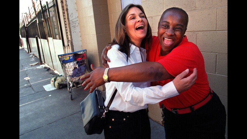 June Fairchild hugs a friend on a return visit to the streets of downtown L.A. in 2001.