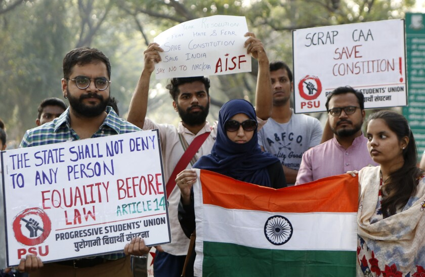 People participate in a protest against Citizen Amendment Act in Mumbai, India, Wednesday, Jan 1, 2020. (AP Photo/Rajanish Kakade)