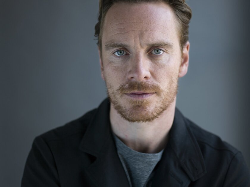 "FILE - In this April 30, 2015 file photo, German-Irish actor Michael Fassbender poses for a portrait to promote his film ""Slow West"" in New York. Fassbender doesn't know if the ""Macbeth"" curse carries over to movie adaptations, but he'd rather not test it. Fassbender's ""Macbeth"" adaption is set to premiere Saturday, May 22, 2015 at the Cannes Film Festival. (Photo by Scott Gries/Invision/AP, File)"