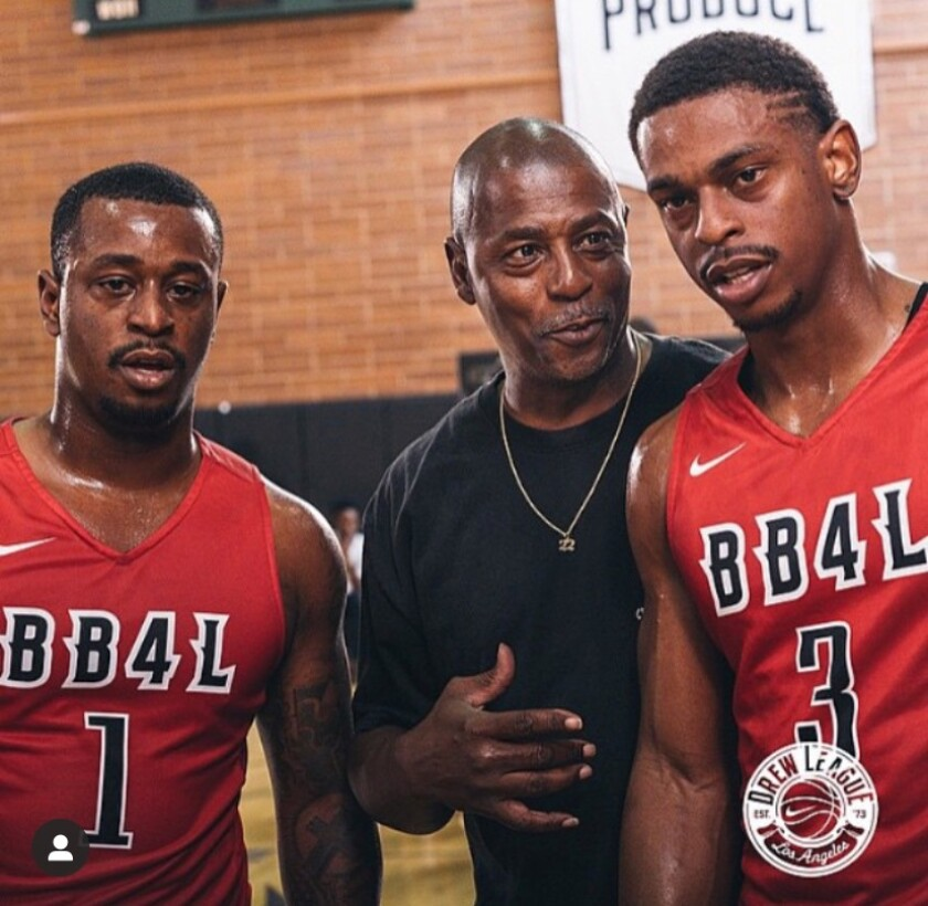 Casper Ware Jr., right, with his father and brother, Ervin, at the Drew League.