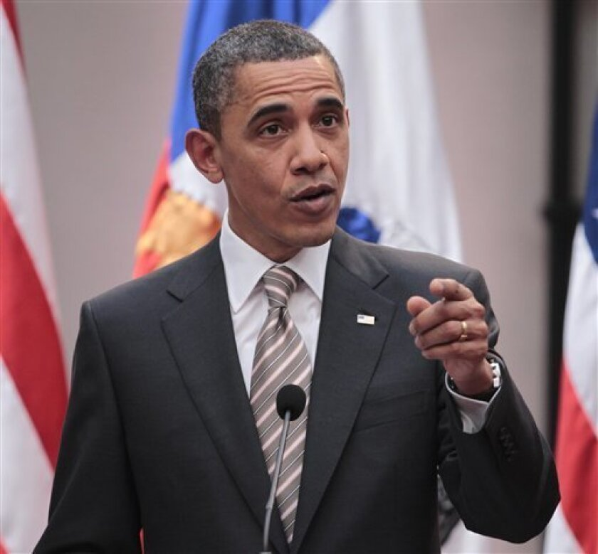President Barack Obama gestures during a joint news conference with Chilean President Sebastian Pinera, Monday, March 21, 2011, at La Moneda Palace in Santiago, Chile. (AP Photo/Pablo Martinez Monsivais)