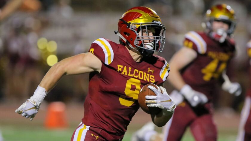 Torrey Pines running back Mac Bingham (shown in an earlier game) scored a San Diego Section-record eight touchdowns in Friday's win over Oceanside.