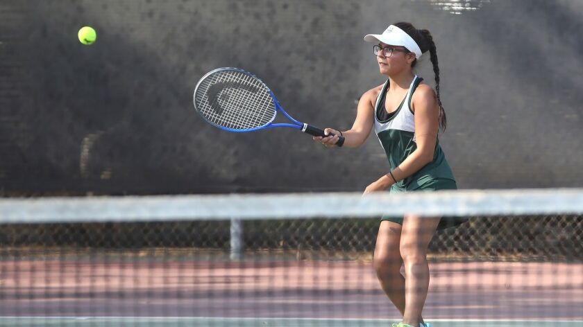 Costa Mesa number one singles player Leslie Delgado hits a forehand during match against Calvary Cha