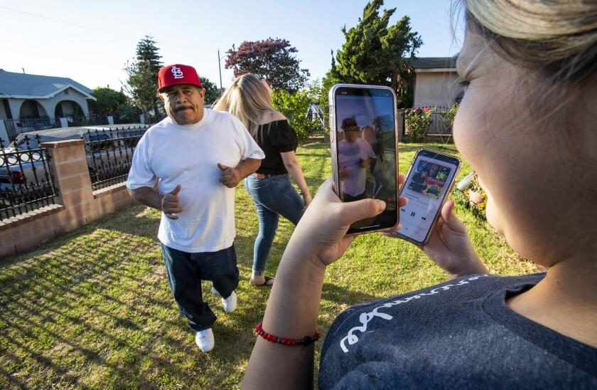 Eveli Paz videotapes father-in-law Genaro Rangel and sister-in-law Wendy Rangel using the TikTok app.