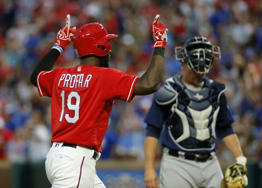 Texas Rangers' Jurickson Profar (19) celebrates as he approaches home on his solo home run as Seattle Mariners catcher Steve Clevenger stands by the plate in the fourth inning of a baseball game on, Friday, June 3, 2016, in Arlington, Texas. (AP Photo/Tony Gutierrez)