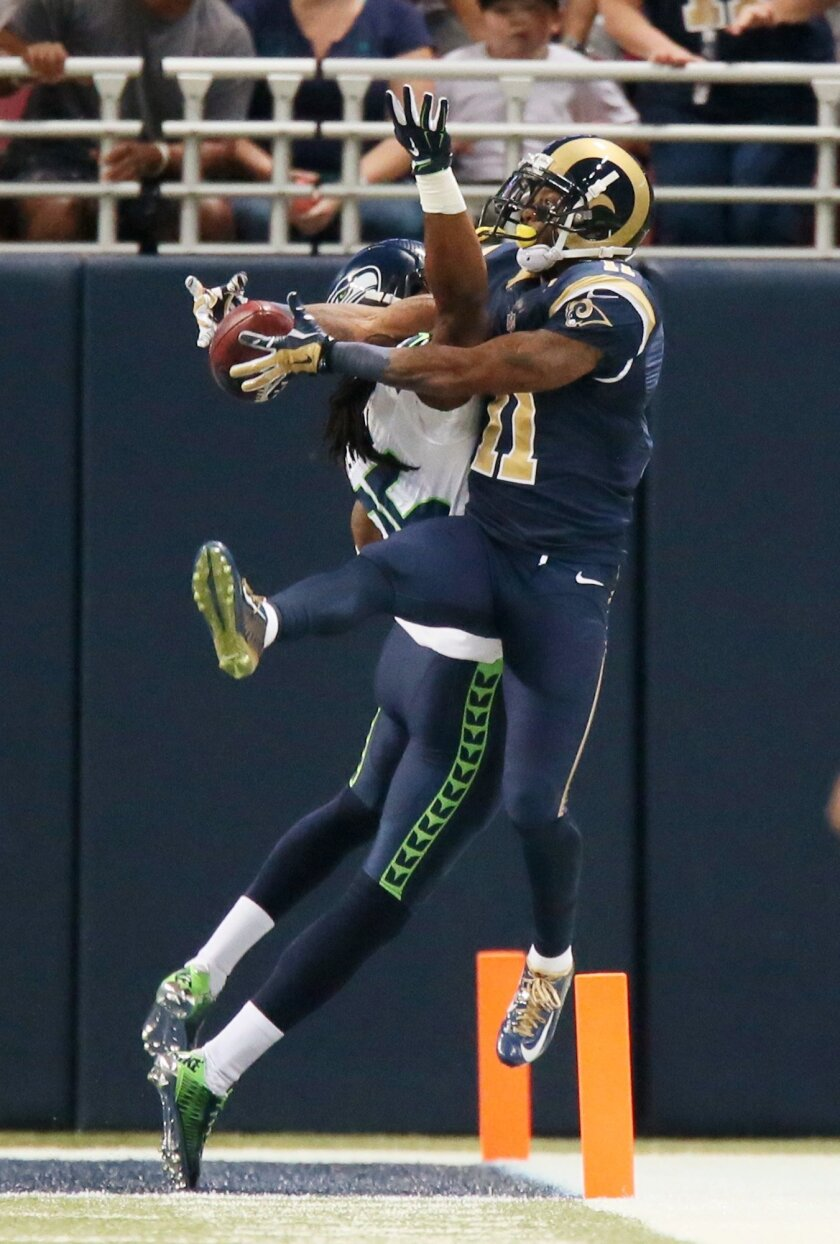 Seattle Seahawks cornerback Richard Sherman (left) breaks up a pass intended for St. Louis Rams wide receiver Tavon Austin in the endzone during the first half of an NFL football game on Sunday, Sept. 13, 2015 in St. Louis. The Rams won 34-31. (Chris Lee/St. Louis Post-Dispatch via AP) EDWARDSVILLE INTELLIGENCER OUT, THE ALTON TELEGRAPH OUT