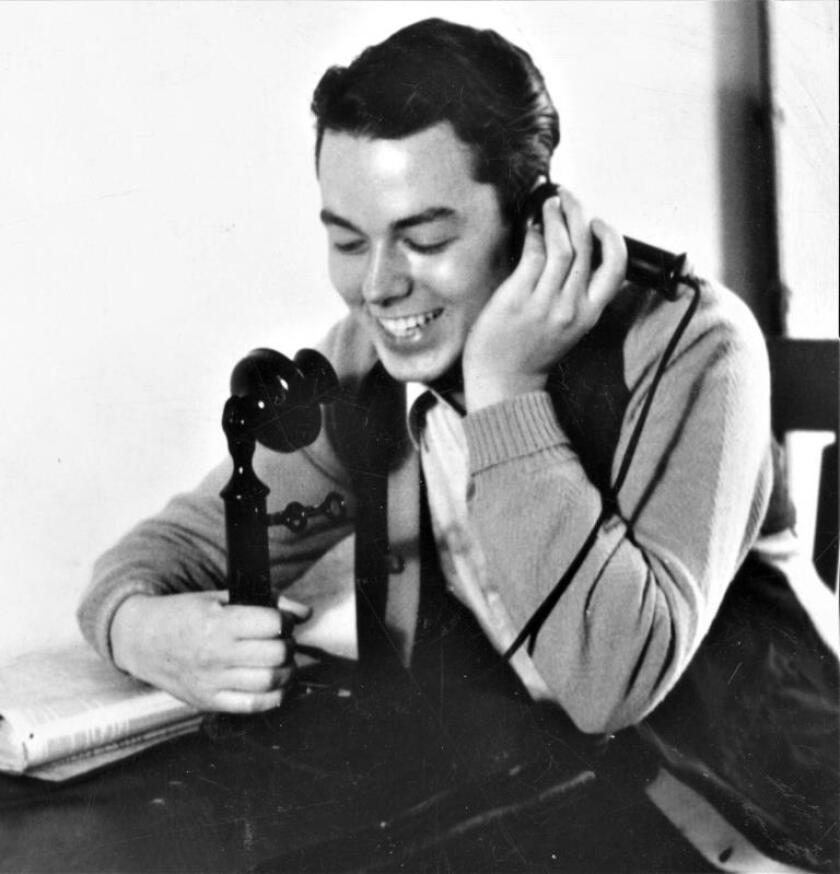 Jim Jackson calls a friend in 1940. He earned a master's degree in divinity in 1941 and was ordained shortly after.