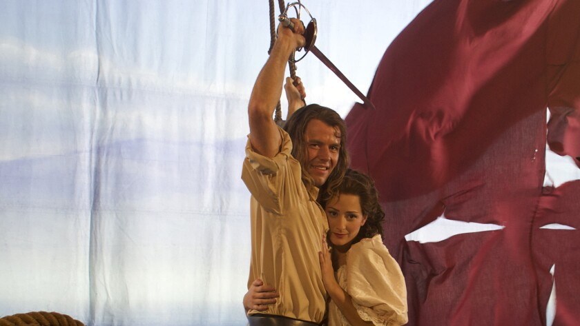 """(L-R) - Thomas Cocquerel and Ashlee Lollback in a scene from """"In Like Flynn."""" Credit: Blue Fox Enter"""