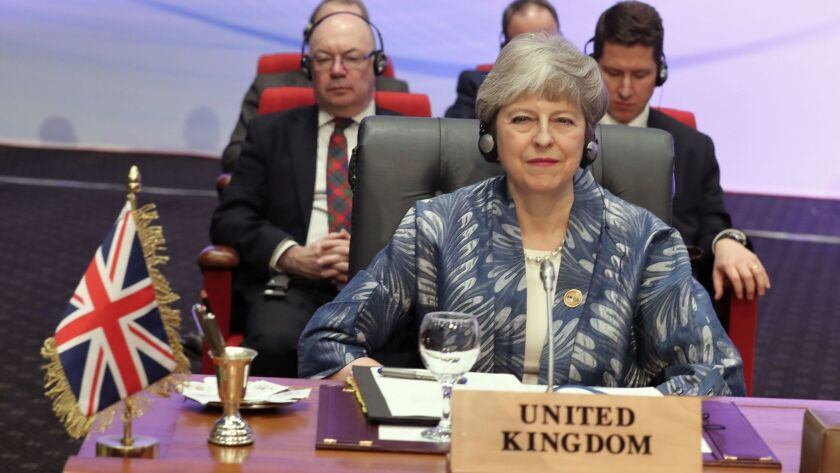 British Prime Minister Theresa May attends the opening of the first EU-Arab League Summit on Feb. 24 in Sharm el-Sheikh, Egypt.