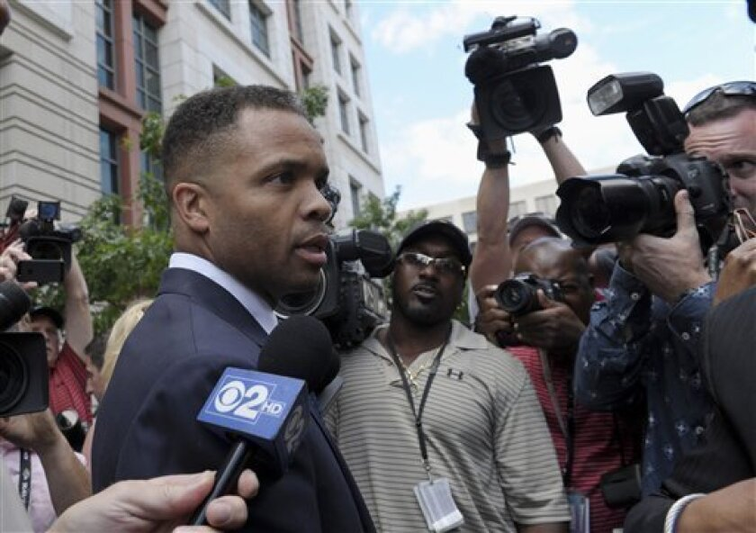 Former Illinois Rep. Jesse Jackson Jr., leaves federal court in Washington, Wednesday, Aug. 14, 2013. Jackson was sentenced to two and a half years in prison Wednesday after pleading guilty to scheming to spend $750,000 in campaign funds on TV's, restaurant dinners, an expensive watch and other costly personal items. His wife received a sentence of one year. (AP Photo/Susan Walsh)