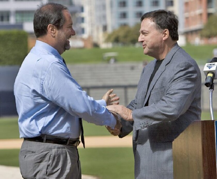 Jeff Moorad (left) is CEO of the Padres, and John Moores (right) is chairman. Both are seen here in 2009 after the announced gradual sale of the team.