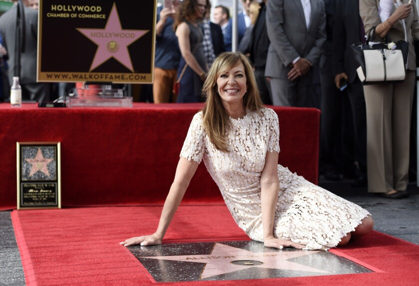 Actress Allison Janney sits alongside her new star on the Hollywood Walk of Fame during a ceremony on Monday in Los Angeles.