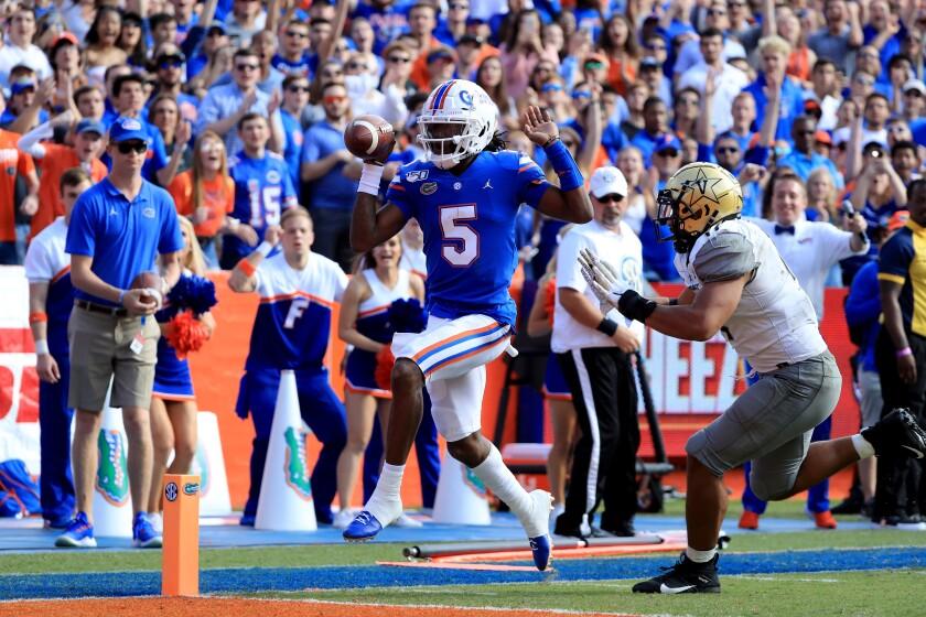 Florida quarterback Emory Jones scores a touchdown against Vanderbilt.
