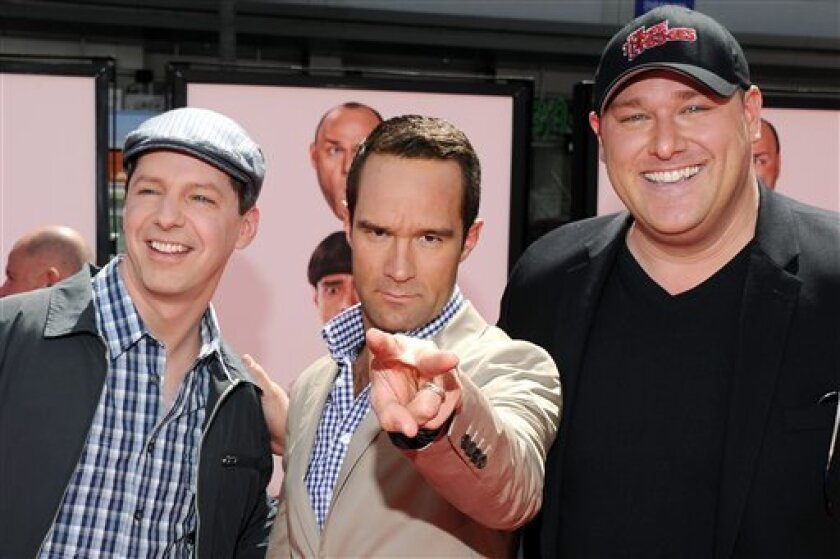 """Actors Sean Hayes, left, Chris Diamontopoulos, center, and Will Sasso arrive at the premiere of """"The Three Stooges: The Movie"""" at Grauman's Chinese Theatre in Los Angeles, Saturday, April 7, 2012. (AP Photo/Vince Bucci)"""