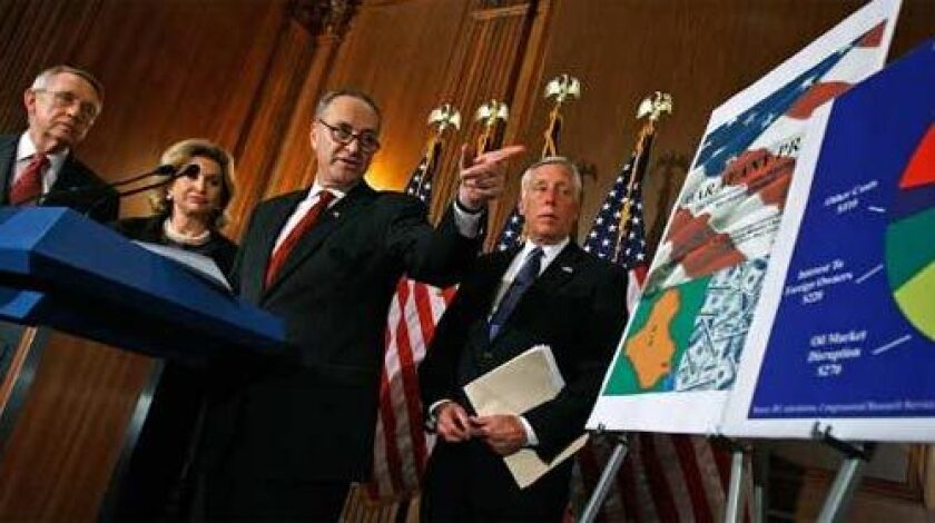 """Joint Economic Committee Chairman Charles Schumer (D-NY), speaks during a news conference with (L-R) Senate Majority Leader Harry Reid (D-NV), Joint Economic Committee Vice Chair Carolyn Maloney (D-NY) and House Majority Leader Steny Hoyer (D-MD) to release a report what they call """"the hidden costs of the war in Iraq"""" at the U.S. Capitol."""