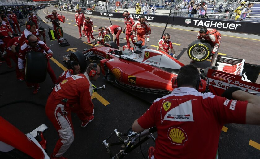 Ferrari driver Sebastian Vettel of Germany steers his car into pit lane for a tire change during the second free practice at the Monaco racetrack in Monaco, Monaco, Thursday, May 26, 2016. The Formula one race will be held on Sunday. (AP Photo/Petr David Josek)