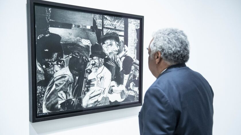Visitor looking at Romare Bearden's Train Whistle Blues No. 1, 1964. Credit: Timothy Noris