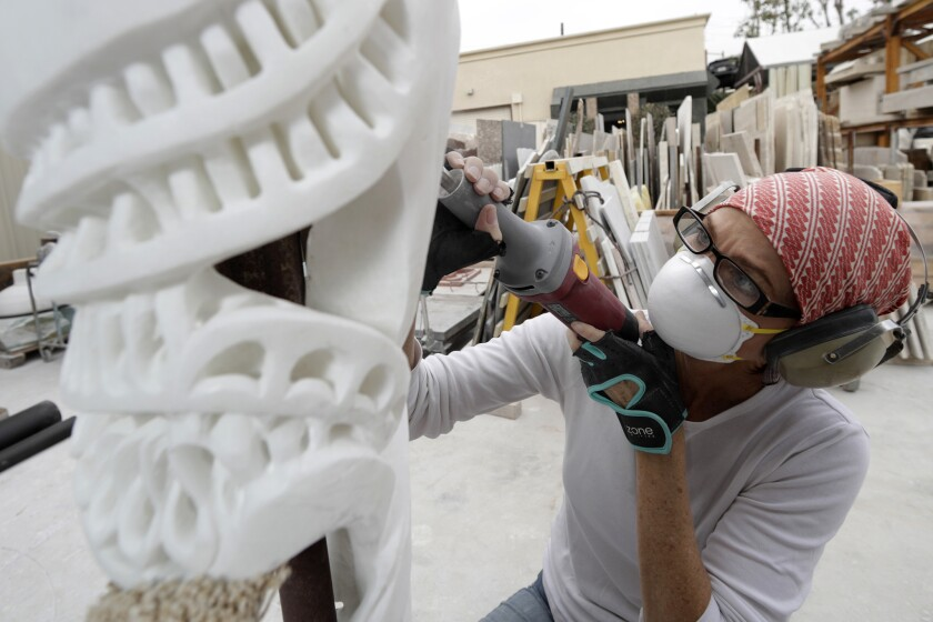 Elizabeth Turk works on a sculpture at her marble studio in Santa Ana.