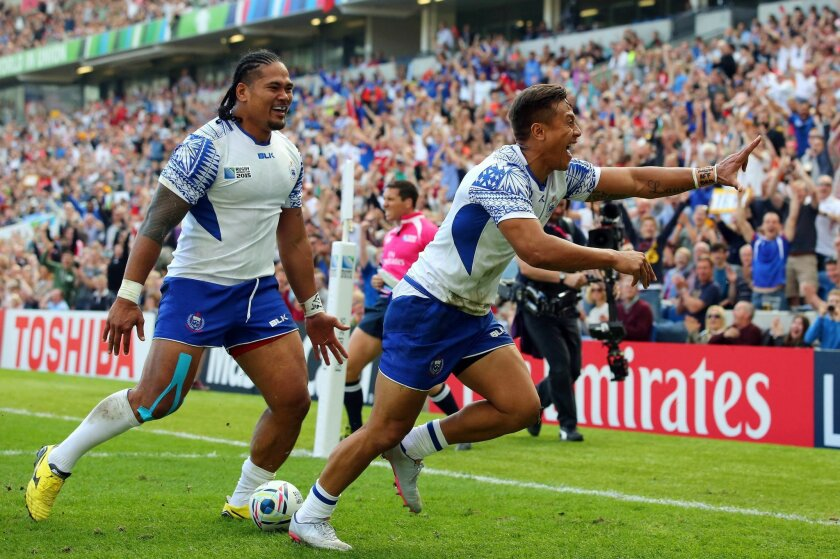 Samoa's Tim Nanai-Williams, right, celebrates scoring a try during the Rugby World Cup Pool B match against USA at the Brighton Community Stadium, Brighton, England, Sunday Sept. 20, 2015. (Gareth Fuller/PA via AP) UNITED KINGDOM OUT