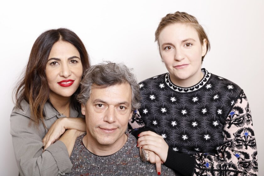 """Director Jason Benjamin, center, poses with producers, Jenni Koner, left, and Lena Dunham for a portrait to promote the film, """"Suited"""", at the Toyota Mirai Music Lodge during the Sundance Film Festival on Sunday, Jan. 24, 2016 in Park City, Utah. (Photo by Matt Sayles/Invision/AP)"""