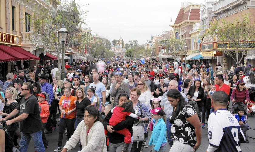 Visitors crowd into Disneyland's Main Street in January. The Anaheim theme park is preparing for even bigger crowds during its 60th anniversary celebration this summer.