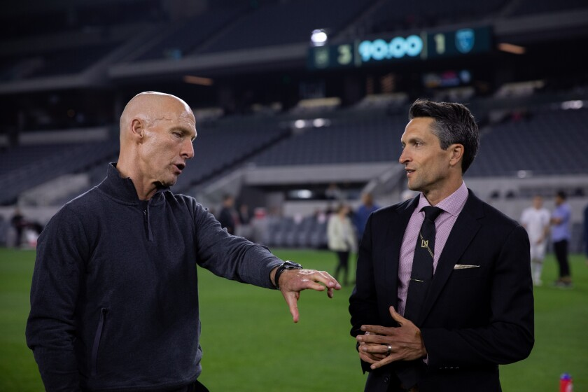 LAFC general manager John Thorrington speaks with coach Bob Bradley.