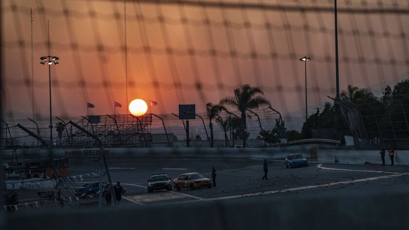 "IRWINDALE, CA - JUNE 15, 2019: The sunsets behind the track during the ""Summer Mayhem"" event at the"