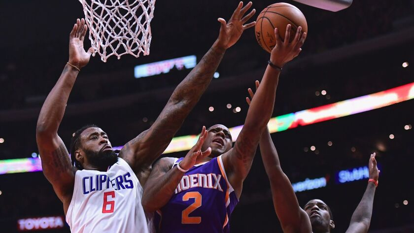 Phoenix's Isaiah Canaan looks to score between Clippers DeAndre Jordan, left, and Jawun Evans on Dec. 20.