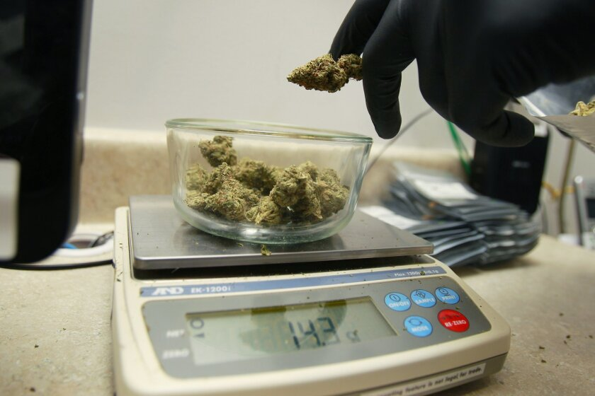 An order is measured at Outliers Collective in El Cajon,  San Diego County's only legal medical marijuana dispensary. It is permitted by the county.