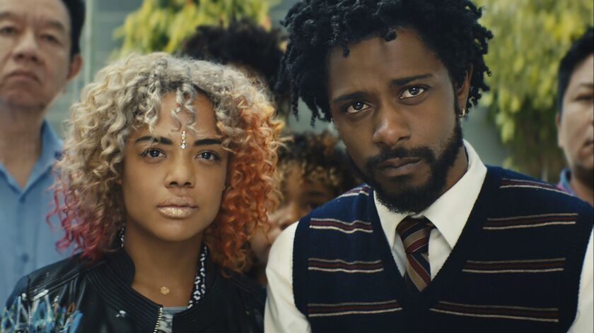 This image released by Annapurna Pictures shows Tessa Thompson, left, and Lakeith Stanfield in a sce