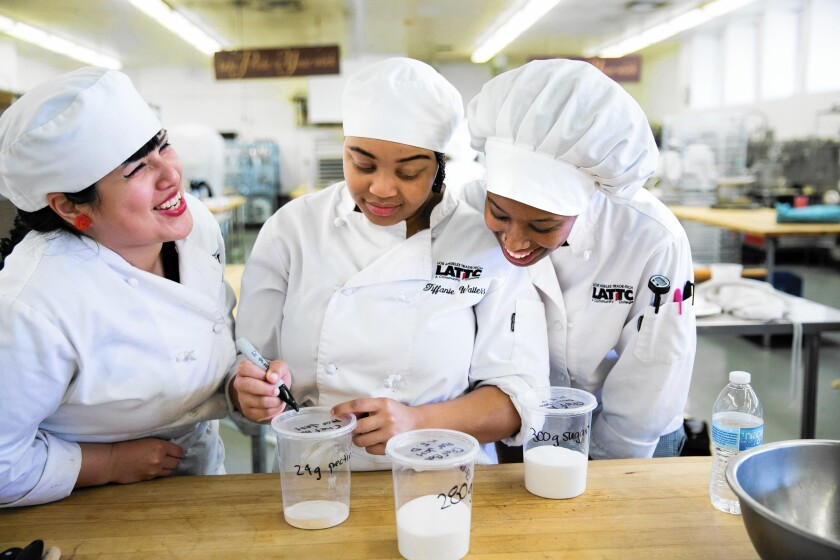 From left, Stephanie Cornejo, Tiffanie Waitess and Taylor Blackwell label tubs of sugary ingredients during their baking class at Los Angeles Trade Tech.