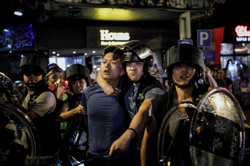 Hong Kong police arrest a protester