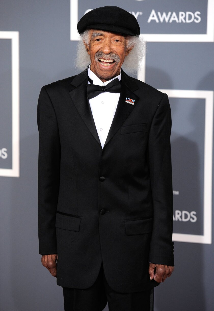 FILE - In this Feb. 12, 2012 file photo, Gerald Wilson arrives at the 54th annual Grammy Awards in Los Angeles. Wilson, the dynamic jazz big band leader, composer and arranger whose career spanned more than 75 years, died Monday, Sept. 8, 2014. He was 96. (AP Photo/Chris Pizzello, File)