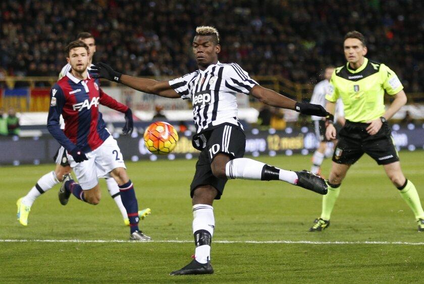 Juventus' Paul Pogba kicks the ball during the Serie A soccer match between Bologna and Juventus at the Dall' Ara stadium in Bologna, Italy, Friday, Feb. 19, 2016. (AP Photo/Antonio Calanni)