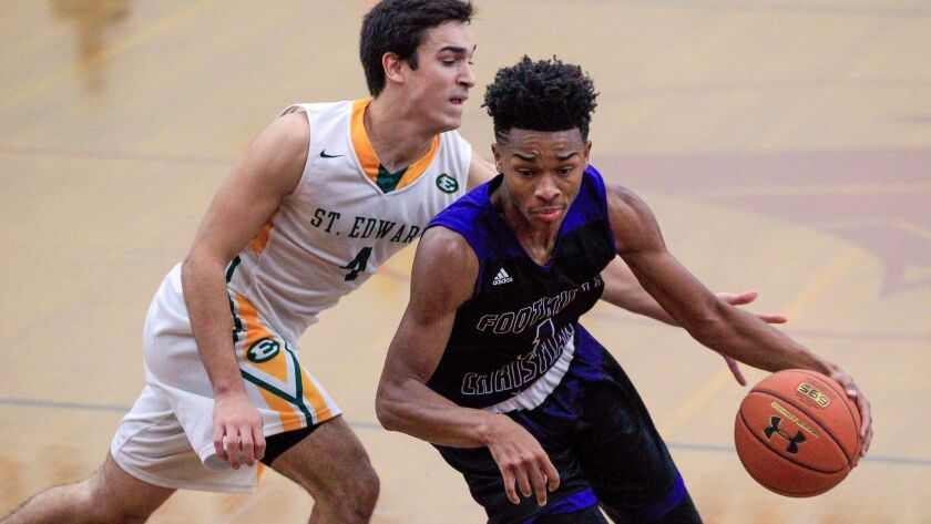 Foothills Christian senior Jaylen Hands, who has signed with UCLA, drives to the basket against Thomas Schmock of St. Edward.
