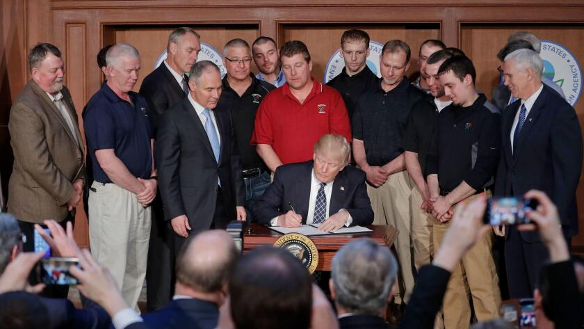 President Trump signs an executive order in 2017.