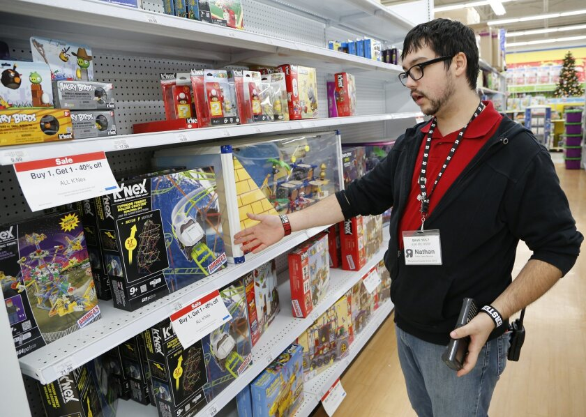 FILE - In this Friday, Dec. 13, 2013, file photo, Nathan Pritchard, with Toys R Us, shows a variety of K'Nex toys on display at the store in Lafayette, Ind. The Commerce Department releases business inventories for December on Thursday, Feb. 13, 2014. (AP Photo/Journal & Courier, John Terhune) NO SALES