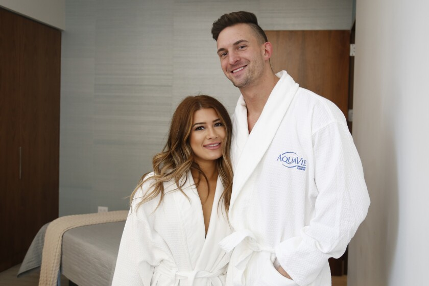 Blind daters Danielle and Ian get ready to de-robe for a couple's massage at AquaVie in downtown San Diego.