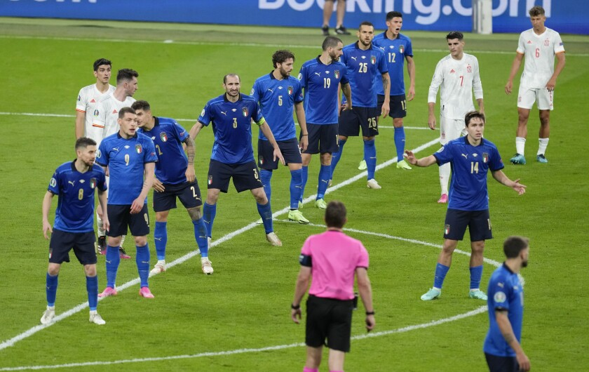Italy line up to defend a free kick during the Euro 2020 soccer championship semifinal between Italy and Spain at Wembley stadium in London, Tuesday, July 6, 2021. (AP Photo/Matt Dunham,Pool)
