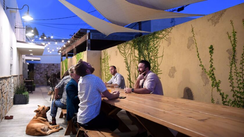 Customers enjoy the patio at Yorkshire Square Brewery in Torrance.