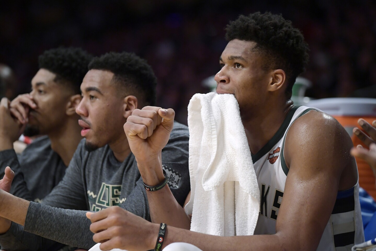 Milwaukee Bucks forward Giannis Antetokounmpo, right, celebrates from the bench after the Bucks scored during the second half of an NBA basketball game against the Los Angeles Lakers on Friday, March 1, 2019, in Los Angeles. The Bucks won 131-120. (AP Photo/Mark J. Terrill)