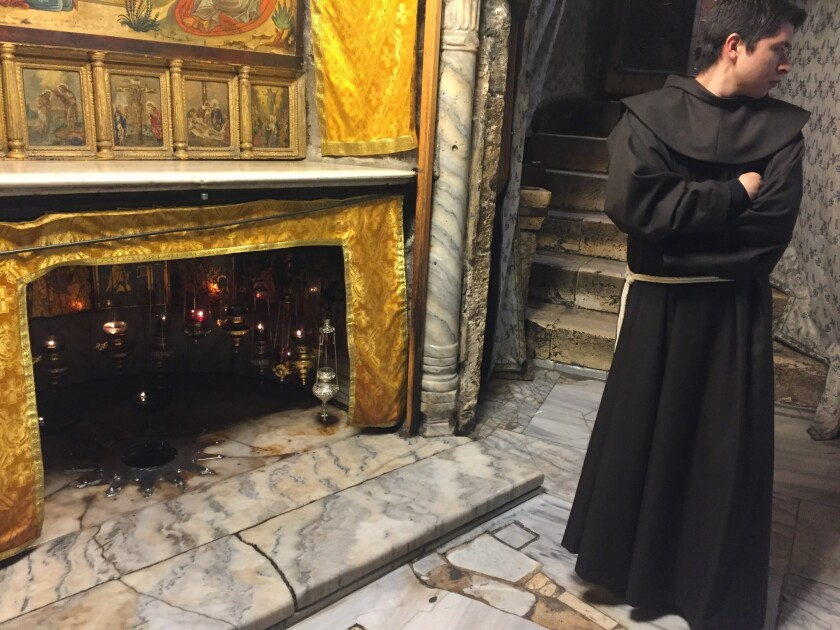 A Franciscan monk stands near the site where Jesus was born in the grotto inside Bethlehem's Church