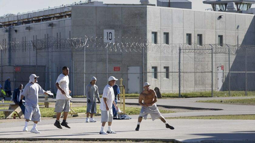VACAVILLE, CALIFORNIA, MARCH 29, 2017: Inmates exercise in the yard at Solano Stet Prison. Passage o