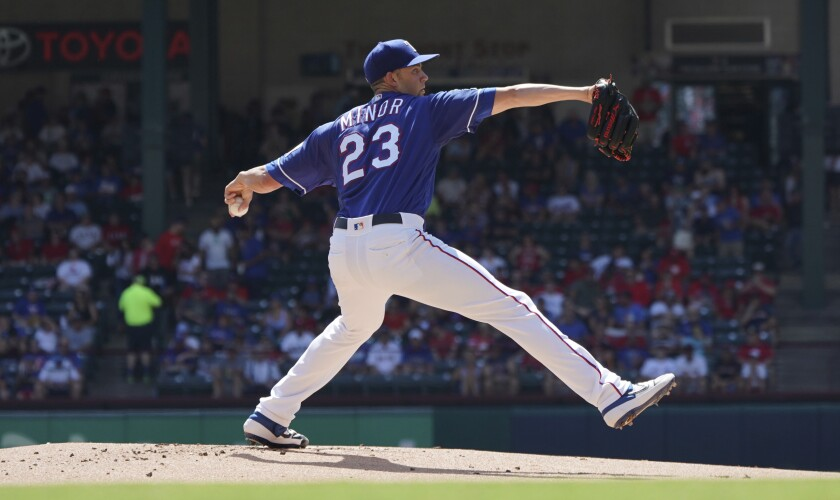 Texas Rangers starting pitcher Mike Minor (23) throws a pitch during the first inning of a baseball game against the Boston Red Sox on Thursday, Sept. 26, 2019, in Arlington, Texas. (AP Photo/Louis DeLuca)