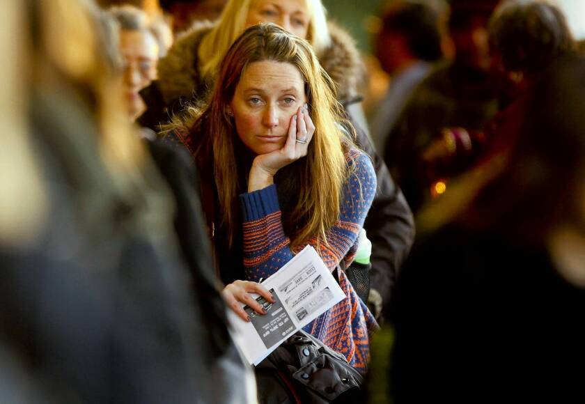 Sarah Barlup waits in line at Southwest Airlines at Los Angeles International Airport to check her baggage for a flight to Philadelphia.
