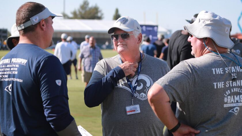 Defensive coordinator Wade Phillips, center, talks to fellow coaches at Rams training camp last August. Phillips, 72, appears trimmed down this year.