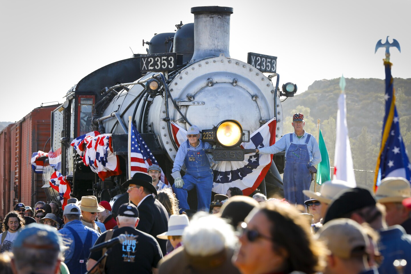 With a 1912 Baldwin steam locomotive in the background that once traveled on the railroad tracks in Campo, those who attended the SD&A Centennial Gold Spike Day at the Pacific Southwest Railway Museum, pose for a group photo, celebrating the 100th anniversary of the completion of the San Diego & Arizona Railway.